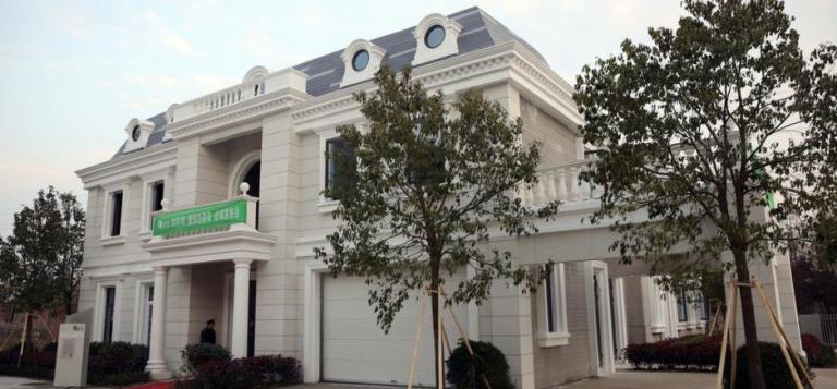 https://3dprinting.com/news/winsun-3d-printed-giant-apartment-building-villa/